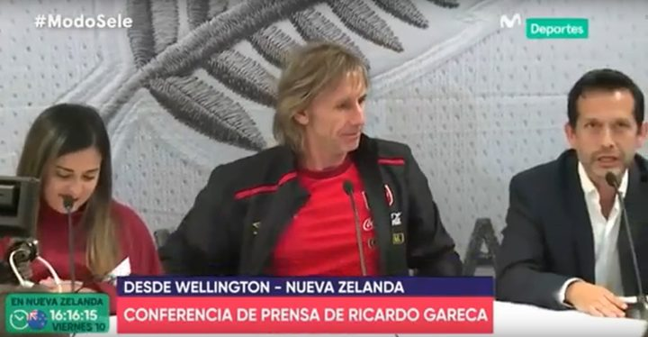 Carlos Gonzales (right) translating for Peru's coach Ricardo Gareca in a press conference seen by millions live in Peru.