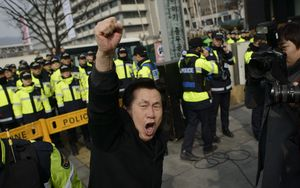 A man takes part in a protest in Seoul against the North Korean regime on Sunday.