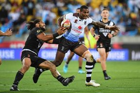 Fiji's Suliasi Vunivalu (R) is tackled by New Zealand's captain Adam Blair during the quarter-final.