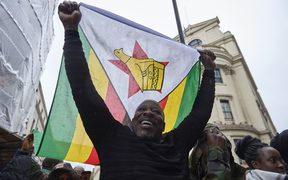 Demonstrators protest outside the Zimbabwe Embassy in London.