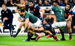 South Africa's Dillyn Leyds heads towards the try-line against France.