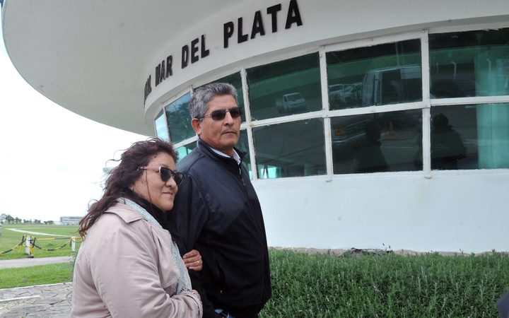 María Morales mother of submarinist Luis Garcia accompnied by an unidentified man at the entrance of Argentina's Navy base in Mar del Plata south of Buenos Aires