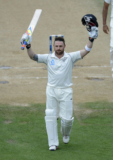 Brendon McCullum celebrates making history