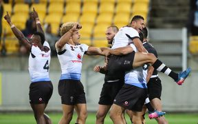 Fiji celebrate the final whistle after beating New Zealand.