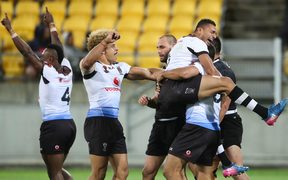Fiji celebrate their quarter final victory over the Kiwis.