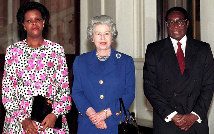 This file photo taken on February 03, 1997 shows Britain's Queen Elizabeth II with President Robert Mugabe of Zimbabwe and his wife Grace, posing for photographers after being the Queen's guest at Buckingham Palace.