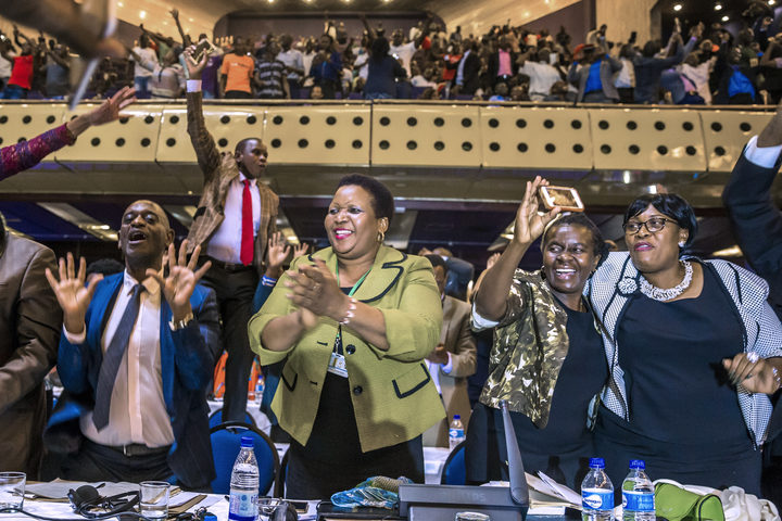Zimbabwe's members of parliament celebrate after Mugabe's resignation.