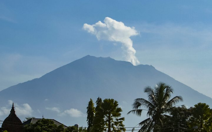 Mount Agung volcano spews steam and smoke into the air in October.