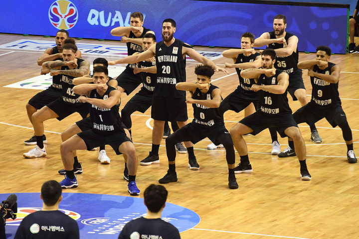 Tall Blacks perform the haka before the start of play.
