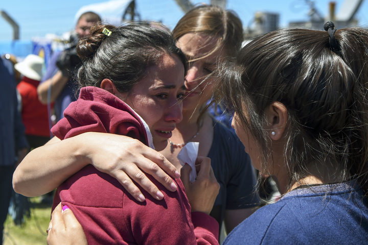 A relative of one of the 44 crew members of Argentine missing submarine, is comforted outside Argentina's Navy base in Mar del Plata.