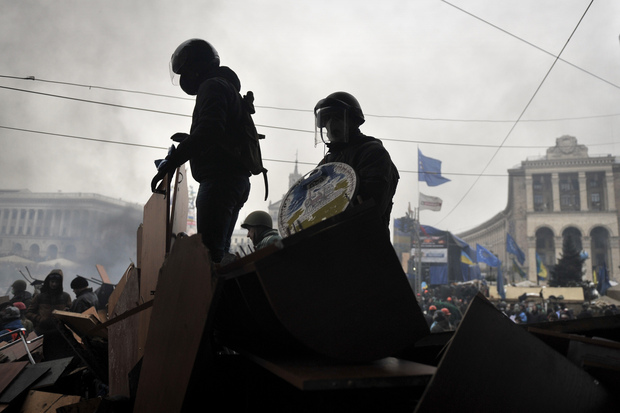 Protesters stand on barricades at Independence square in Kiev.