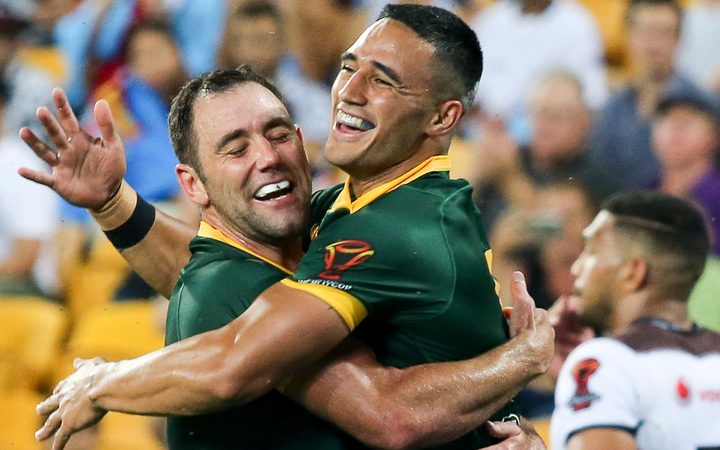 Cameron Smith celebrates with Valentine Holmes after Holmes scores his fifth try. Australia v Fiji.
