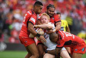 England's James Graham wrapped up by Tonga