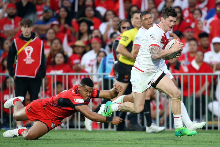 England's John Bateman runs for a try during the Rugby League World Cup semi-final against Tonga.