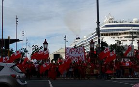 Tongan rugby league fans protest at Auckland's ferry terminal.
