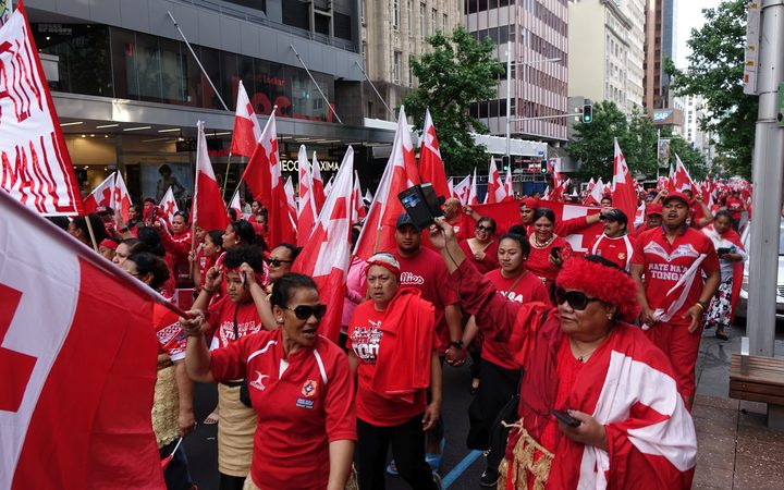 Tongan fans march down Queen Street after the loss to England in the rugby League World Cup semi-final.