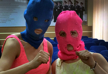 Wearing their signature ski-masks, Pussy Riot members Nadezhda Tolokonnikova (left) and Maria Alyokhina pose for a photo in a police station after their arrest on Tuesday.