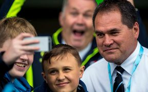 Glasgow Warriors' coach Dave Rennie poses for a picture with fans.