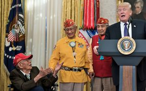 US President Donald Trump speaks in the Oval Office of the White House during an event to honor Native American code talkers who served in World War II