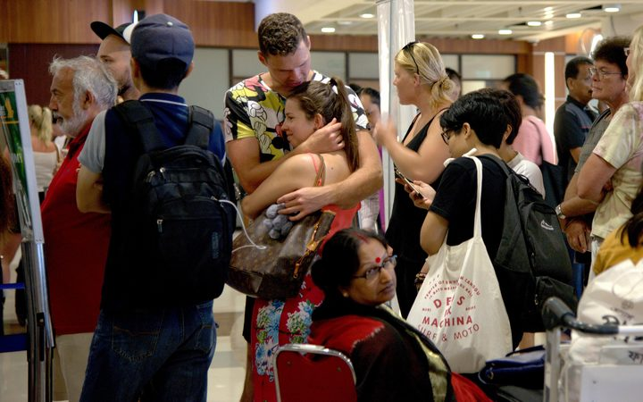 Passengers trapped by cancelled flights due ot ash from Mt Agung at the Ngurah Rai International airport in Denpasar, Bali.