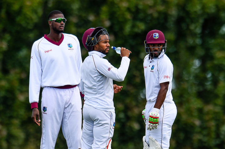 West Indies players Jason Holder with Shai Hop  and Sunil Ambris during Day 1 of the warm-up Cricket match against New Zealand on Saturday.