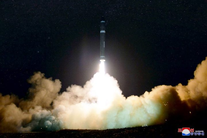 A photo released by North Korea's official Korean Central News Agency (KCNA) shows launching of the Hwasong-15 missile.