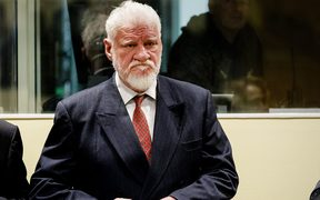 Former general Slobodan Praljak stands prior to the start of his appeal judgement at the International Criminal Tribunal.