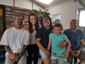 PM Jacinda Ardern pictured with state abuse victims.
