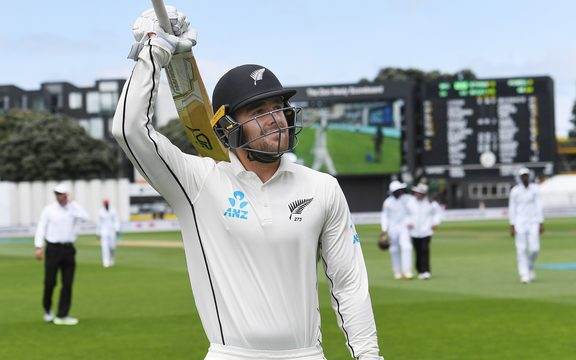Tom Blundell celebrates a century on test debut.