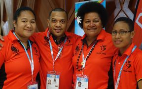 Chef de Mission Emma Wawai, (2nd from right), and members of Team PNG