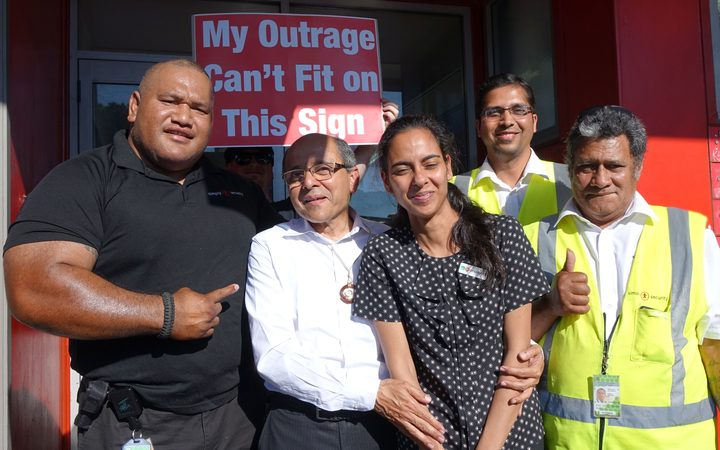 Bhaskar Desai (second from left) and some of his supporters at the protest against Kiwibank removing its services from his shop.