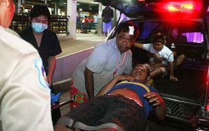Thai hospital workers evacuate an injured villager after the attack.