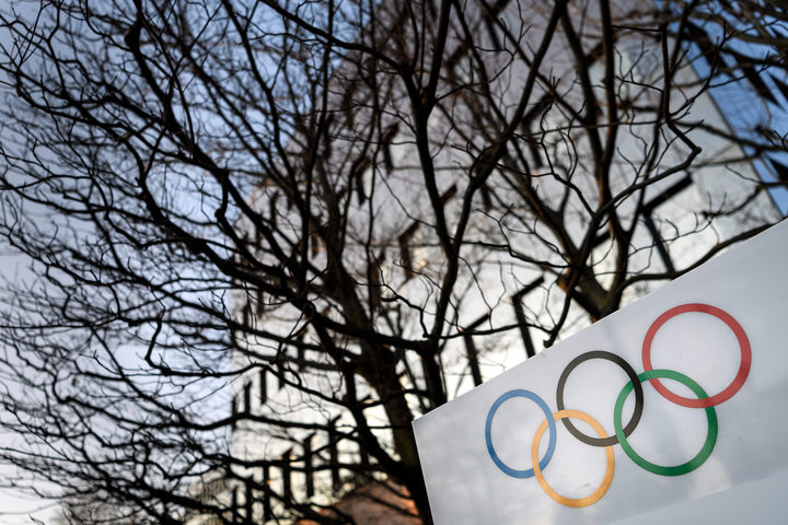 Olympic Rings are seen in front of the International Olympic Committee (IOC) headquarters on December 5, 2017 in Pully near Lausanne.