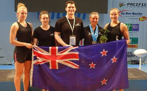 The NZ team celebrates Amanda Gould's three silver medals