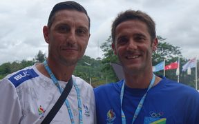 Fiji football coach Christophe Gamel, (left), and Solomons coach Felipe Vega-Arango
