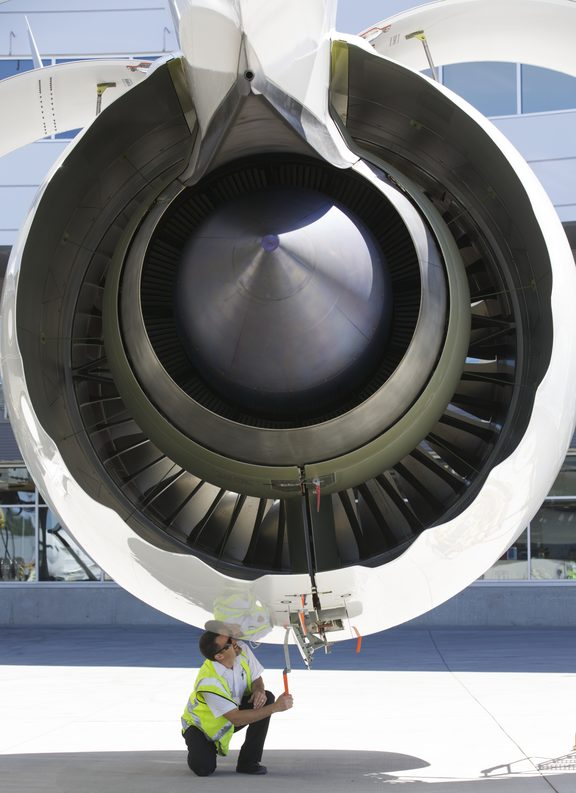 A crew member works on the Rolls Royce engine of an Air New Zealand Boeing 787-9 Dreamliner in 2014.