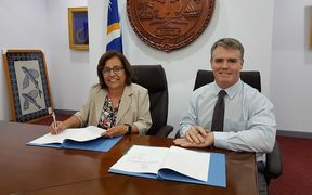 Marshall Islands president Hilda Heine signs an energy project funding grant with the ADB, represented by Michael Trainor, 8 December 2017 in Majuro.