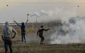 A Palestinian protester hurls a rock at Israeli forces during clashes near the Israel-Gaza border east of Gaza City.