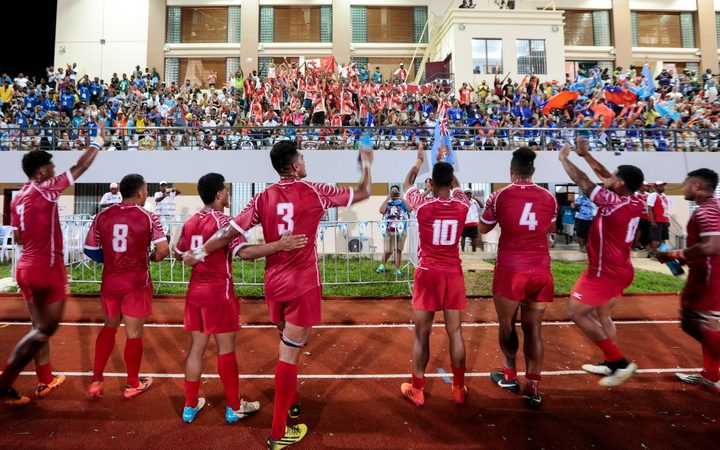 Tonga celebrate their bronze medal and qualification for Rugby World Cup Sevens.