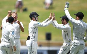 The Black Caps celebrate the fall of another West Indies wicket.