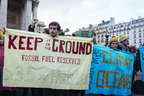 Campaigners urge companies at the  Paris summit to phase out fossil fuels.