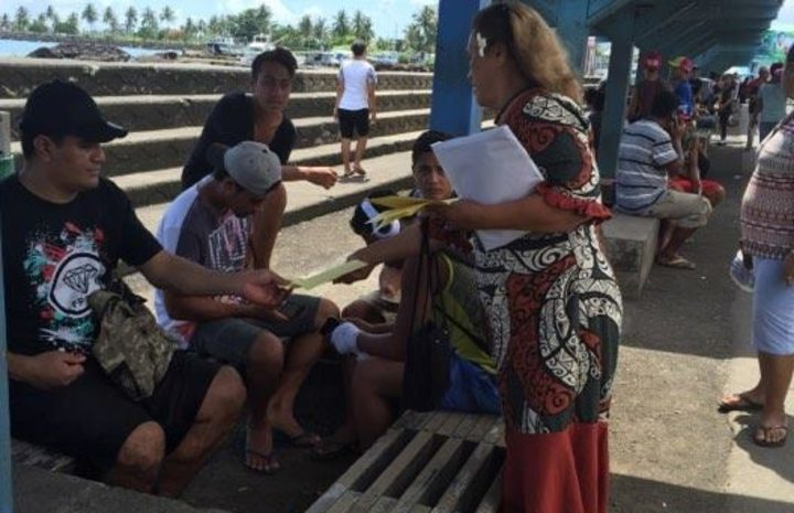 Samoa Solidarity International Group's Ruta Lealaitafea Westin handing out pamphlets to people at the Makeki in Apia. December 2017.