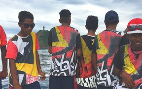 Boys wearing t-shirts with design based on the flag of Timor Leste