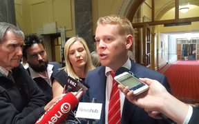 Chris Hipkins talks to media.