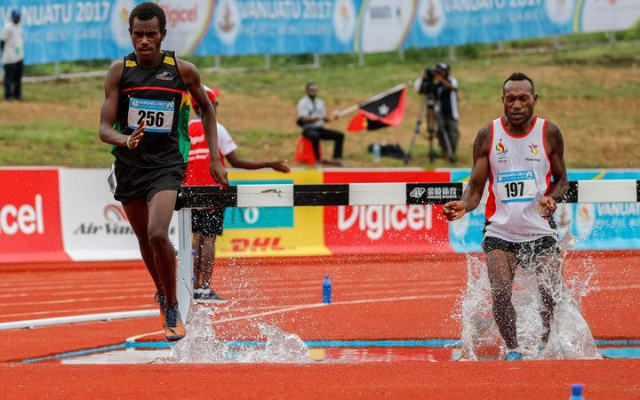 Charley Simon (L) won his second gold medal of the Mini Games in the men's 3000m steeplechase.