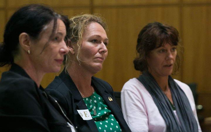 Sue Grey (left) is representing medicinal cannabis activist Rose Renton (centre), pictured here presenting a submission to a parliamentary select committee (file photo)