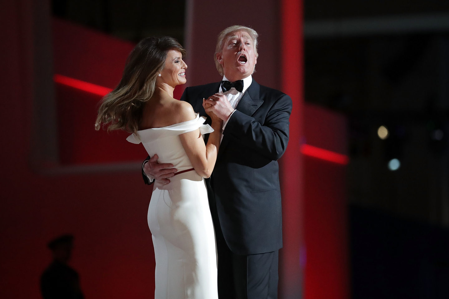 "January: US President Donald Trump sings to the song ""My Way"" while dancing with first lady Melania Trump following his inauguration."