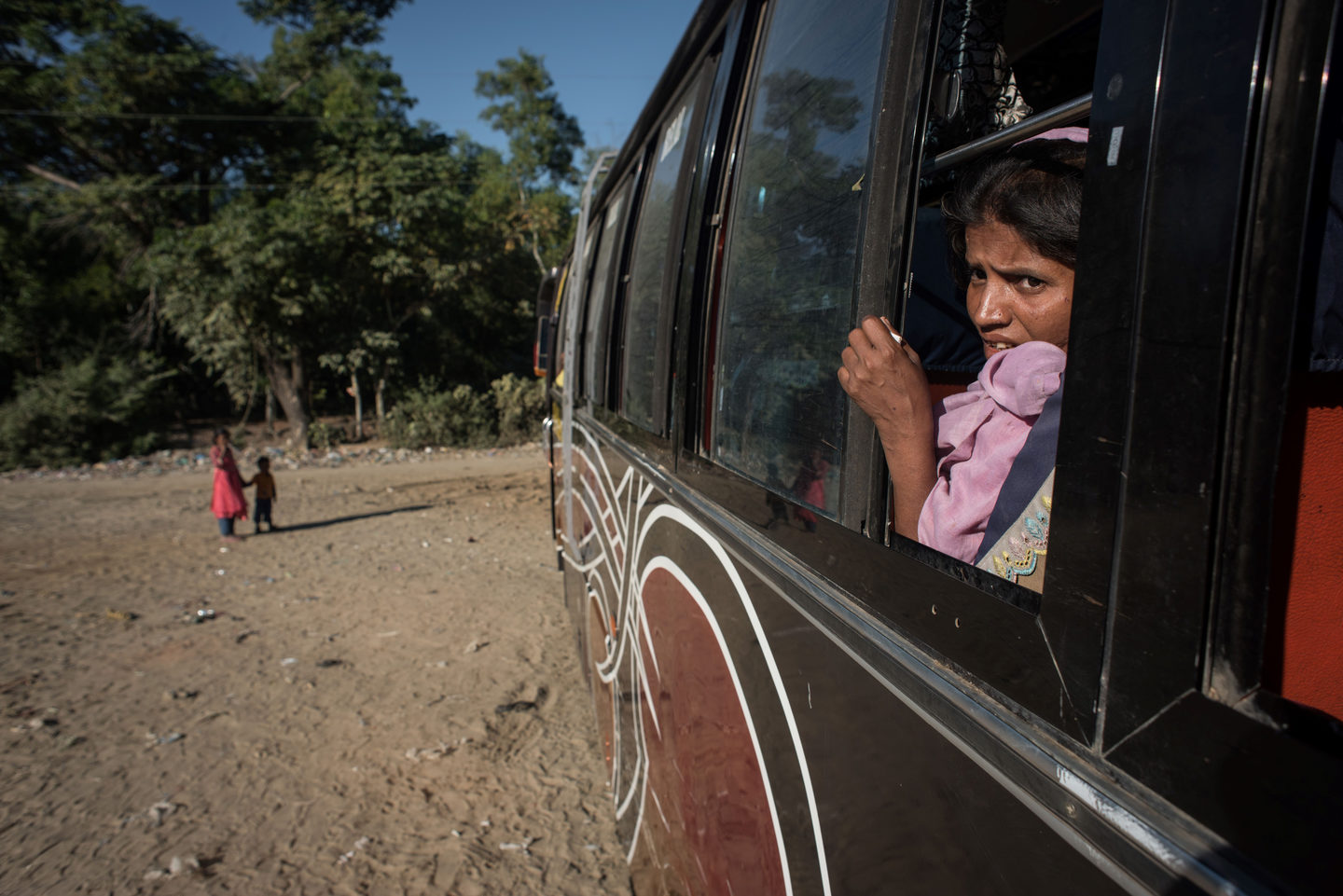 A Rohingya sits aboard a bus leaving for a refugee camp after arriving from Myanmar, near Shah Barir Dip at Cox's Bazar on December 3, 2017.