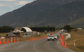 Vehicles head through onto the newly reopened stretch of SH1 north of Kaikoura.
