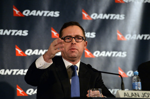 Alan Joyce announcing the cuts at a news conference in Sydney on Thursday.